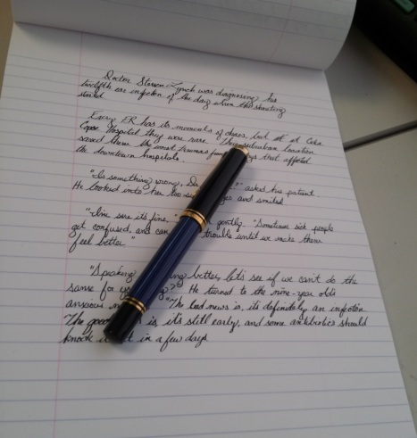 Pen with written notebook